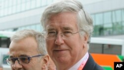 FILE - British Secretary of State for Defence Michael Fallon.