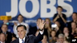 Capres partai Republik Mitt Romney menyoroti pengangguran yang meningkat dalam kampanye di Wisconsin Products Pavilion at State Fair Park, Wisconsin (2/11).