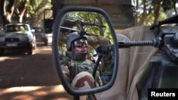A French soldier is reflected in the mirror of a military jeep in Niono, Mali, January 20, 2013.