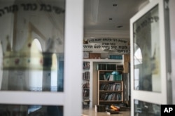 Jewish holy books are seen at a library at Hara Kbira, on the island of Djerba, southern Tunisia, Oct. 30, 2015.
