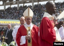 Pope Francis arrives to lead a mass at the Bangui stadium, Central African Republic, Nov. 30, 2015.