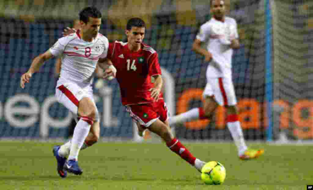 Morocco's Baussoufa Mbarak plays against Tunisia's Korbi Khaled during their African Cup of Nations Group C soccer match in Libreville