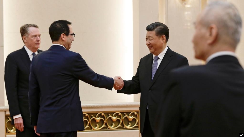 Bộ trưởng Tài chính Mỹ bắt tay với Chủ tịch Trung Quốc, 15/2/2019