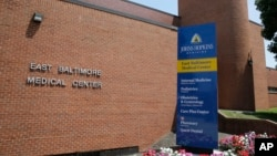 This July 8, 2014, photo shows the East Baltimore Medical Center, an affiliate of Johns Hopkins Hospital in Baltimore, where Dr. Nikita Levy worked when allegations he videotaped his female patients during pelvic exams came to light.