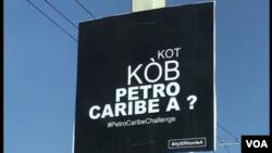 Yon ansèy Petro Caribe ki koke nan yon poto elektrik.