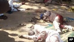 Bodies lies on the ground following a bomb explosion in Yola, Nigeria, Friday, Oct. 23, 2015. Two suicide bombers struck at city mosques in northeast Nigeria on Friday, killing over 40 people and wounding more than 100, an official and witnesses said. (AP/Ibrahim Abdulaziz)