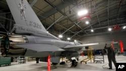 FILE - A U.S. F-16 fighter jet is seen in a hangar in South Burlington, Vermont, Dec. 17, 2012.