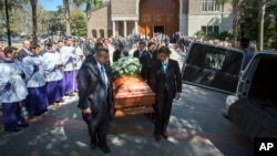 Pallbearers carry Pat Conroy's casket out of St. Peter's Catholic Parish after his funeral mass in Beaufort, South Carolina, March 8, 2016.