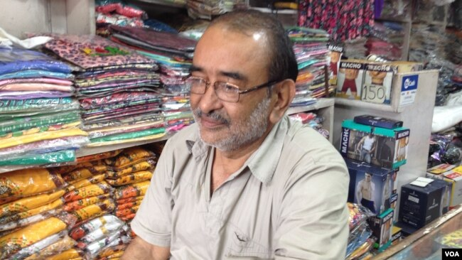 Shopkeeper Ganesh Singh in Haridwar says efforts are being made to educate people about not throwing plastic and other waste in the river or along its banks. (A. Pasricha/VOA)