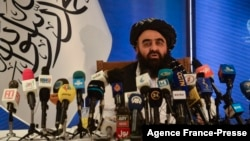 FILE - The Taliban's foreign minister, Amir Khan Muttaqi, speaks to the media in Kabul, Afghanistan, Sept. 14, 2021.