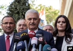 Turkish Prime Minister Binali Yildirim speaks to the media in Ankara, Turkey, Sept. 22, 2017.