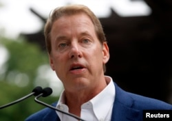 FILE - Executive Chairman of Ford Motor Co., Bill Ford Jr. addresses the public outside the Historic Ford Estate, once the home of his great-grandparents Henry and Clara Ford, during a celebration in honor of what would have been the 150th birthday of Henry Ford.