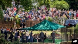 Family, friends and fans attend Gregg Allman's burial at Rose Hill Cemetery, June 3, 2017, in Macon, Ga.