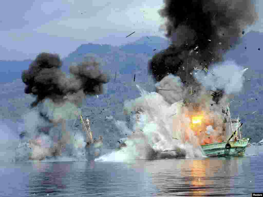 Two foreign-flagged fishing boats registered in Papua New Guinea are destroyed by the Indonesian Navy after they were seized earlier for supposedly illegal fishing off the coast of Ambon, Maluku.