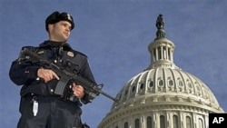 Capitol Police officer Angel Morales stands guard on the West side of the Capitol in Washington after a man was arrested in an FBI sting operation near the U.S. Capitol while planning to detonate what police say he thought were live explosives, February 1