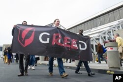 FILE - Protesters demonstrate against high prices of pharmaceutical company Gilead in March 2013 in Atlanta.