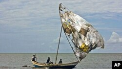 Turkana men sail their fishing boats near the shores of Lake Turkana, northeast of Kenya's capital Nairobi, August 10, 2011