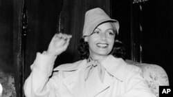 FILE - In this July 17, 1946, file photo, Greta Garbo smiles on her arrival in Gothenburg, Sweden. The New York Times reports that her Manhattan co-op is on the market for $5.95 million.