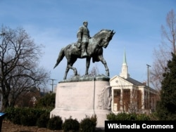 FILE - A statue of Confederate General Robert E. Lee in a Charlottesville, Va., park.