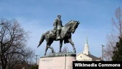 FILE - A statue of Confederate General Robert E. Lee in Charlottesville, Va.
