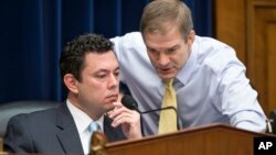House Oversight and Government Reform Committee Chairman Rep. Jason Chaffetz, R-Utah, left, confers with committee member Rep. Jim Jordan, R-Ohio, on Capitol Hill in Washington, on Dec. 17, 2015.