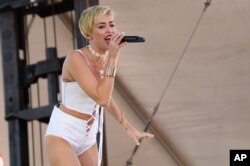 Miley Cyrus performs at IHeartRadio Music Village, Sept. 21, 2013 in Las Vegas.