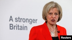Britain's Home Secretary Theresa May speaks at a news conference in London, March 23, 2015.