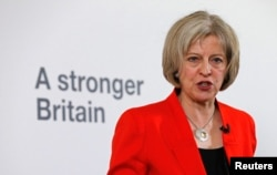 FILE - Britain's Home Secretary Theresa May speaks at a news conference in London, March 23, 2015.