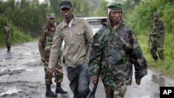 Congolese M23 rebel soldiers are seen on the road to Rushura, some 25 kilometers north of Goma, Nov. 22, 2012.