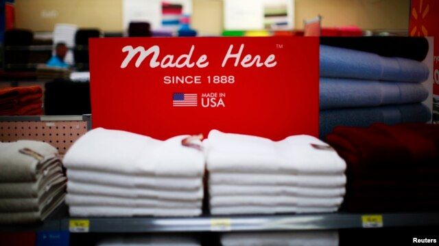 FILE - U.S.-manufactured apparel is featured on a shelf at a Walmart store in Rogers, Arkansas, June 6, 2013.