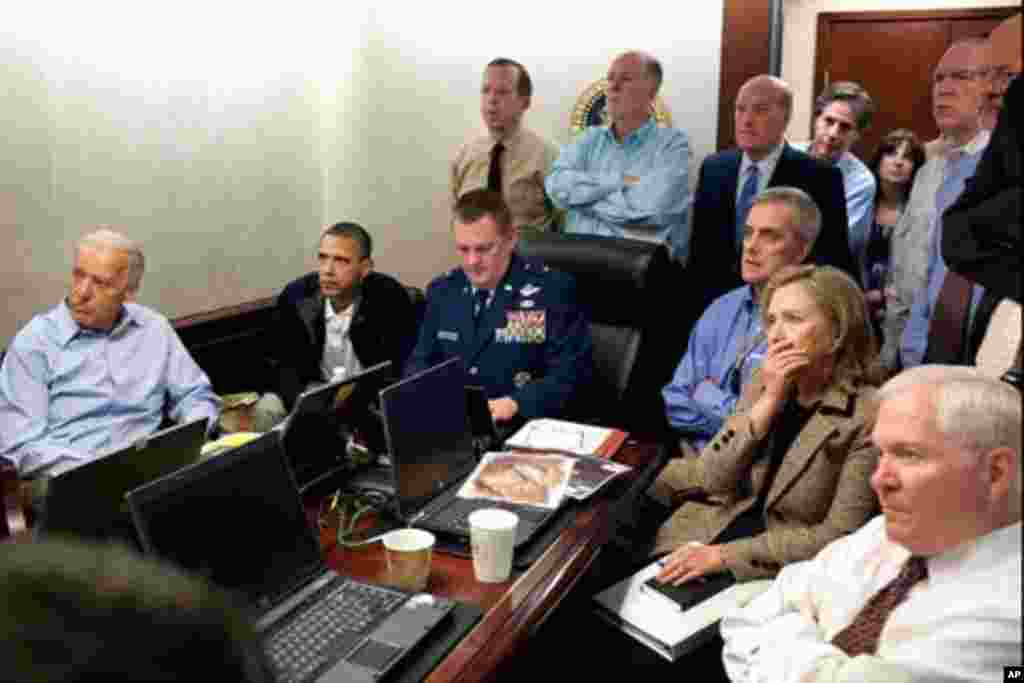 President Barack Obama and Vice President Joe Biden, along with members of the national security team, receive an update on the mission against Osama bin Laden in the Situation Room of the White House, May 1, 2011. Seated, from left, are: Brigadier Genera