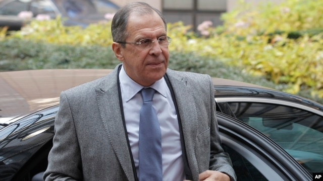 Russia's Foreign Minister Sergei Lavrov arrives for an EU foreign ministers meeting at the European Council building in Brussels, Dec. 16, 2013.