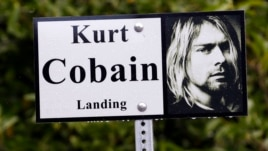 "In this photo taken Monday, Sept. 23, 2013, a sign marks the location of ""Kurt Cobain Landing,"" a tiny park blocks from the childhood home of Kurt Cobain, the late frontman of Nirvana, in Aberdeen, Wash."