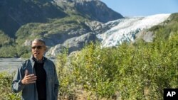 President Barack Obama speaks to members of the media while on a hike to the Exit Glacier in Seward, Alaska, Sept. 1, 2015. (AP Photo/Andrew Harnik)