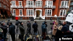 Members of the media wait opposite the Ecuadorian embassy in central London, Britain, Feb. 5, 2016. A U.N. panel said Friday that Wikileaks founder Julian Assange was being detained arbitrarily and should be released and compensated.