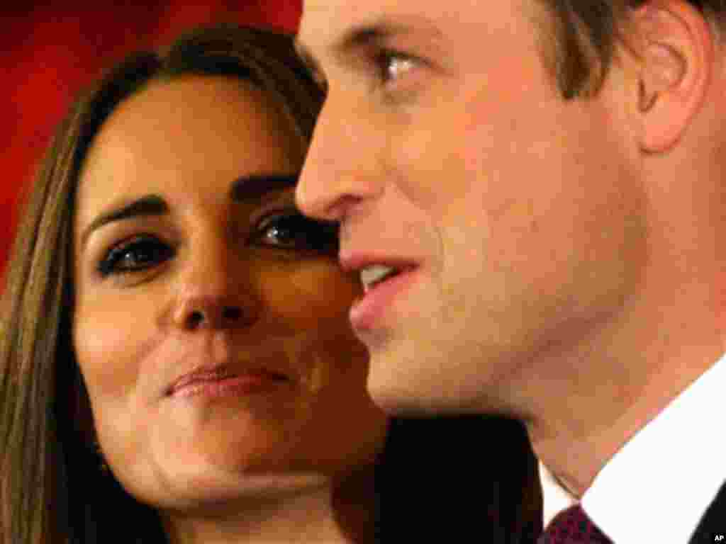 Nov 16: Britain's Prince William and his fiancee Kate Middleton pose for the media at St. James's Palace in London after announcing their marriage. The couple are to wed in 2011.(AP Photo/Sang Tan)
