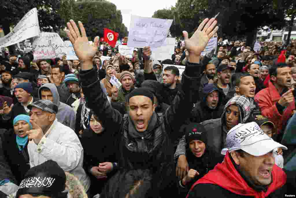 Supporters of the ruling Ennahda party shout slogans in support of the party during a demonstration in Tunis, Feb. 9, 2013.