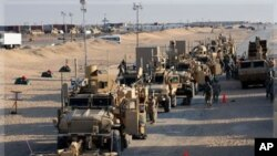 US Army soldiers from the 1st Cavalry Division, the last soldiers to leave Iraq, arrive at Camp Virginia, Kuwait, Dec. 18, 2011.