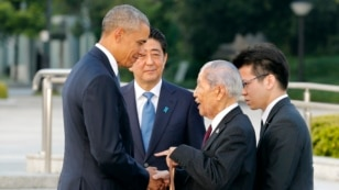 U.S. President Barack Obama, left, shakes hands and chats with Sunao Tsuboi, second right, a survivor of the 1945 atomic bombing and chairman of the Hiroshima Prefectural Confederation of A-bomb Sufferers Organization (HPCASO), as Japanese Prime Minister