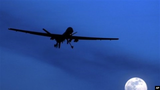 A U.S. Predator drone flies over the moon above Kandahar Air Field, southern Afghanistan (File Photo)