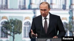 FILE - Russian President Vladimir Putin speaks during a session of the St. Petersburg International Economic Forum 2015, St. Petersburg, Russia, June 19, 2015.