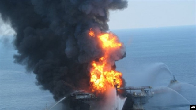 This US Coast Guard image released on April 22, 2010 shows fire boat response crews as they battle the blazing remnants of the off shore oil rig Deepwater Horizon, 21 April 2010.