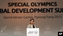Myanmar opposition leader Aung San Suu Kyi speaks at the Global Development Summit during the 10th Special Olympics World Winter Games in Pyeongchang, South Korea, Wednesday, Jan. 30, 2013. South Korea began showing off its new snow sports mecca with th