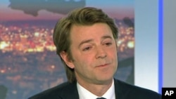 France's Finance and Economy Minister Francois Baroin is seen in this still image taken from video as he speaks on national TV after the downgrade of France's AAA rating, in Paris, January 13, 2012.