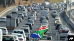 Traffic moves slowly near Soccer City Stadium in Johannesburg on the opening day of the 2010 World Cup football tournament in South Africa, 11 Jun 2010