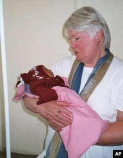 Jill Sheffield holds a baby born to a mother at one of the FCI-affiliated maternal health clinics in Ecuador.