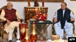 FILE - Indian Prime Minister Narendra Modi, left, and Pakistan Prime Minister Nawaz Sharif meet in Lahore after Modi paid a surprise visit, Dec. 25, 2015.