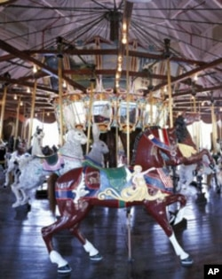 On Burlington, North Carolina's prized menagerie carousel, other animals - like these giant hares - share the limelight.