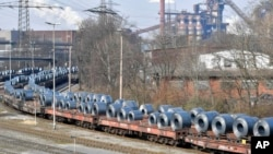 FILE - Steel coils sit on wagons when leaving the thyssenkrupp steel factory in Duisburg, Germany, March 2, 2018.