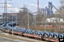 Steel coils sit on wagons when leaving the thyssenkrupp steel factory in Duisburg, Germany, Friday, March 2, 2018